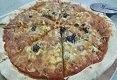 תמונת רקע פיצה מחמצת בטאבון באר שבע